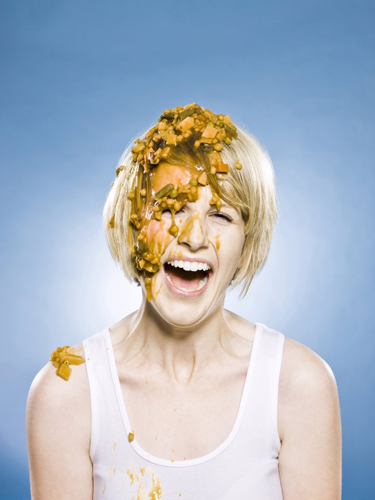 Stock Photo: 1660R-61538 woman getting food dumped on her head