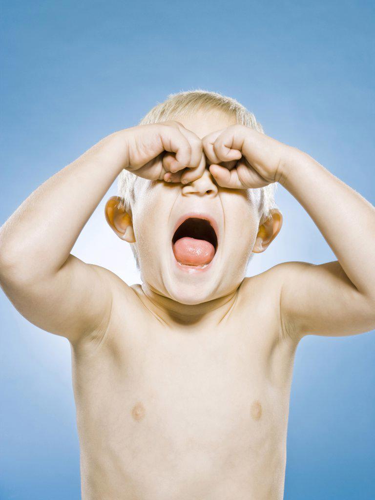 Stock Photo: 1660R-61642 boy rubbing his eyes