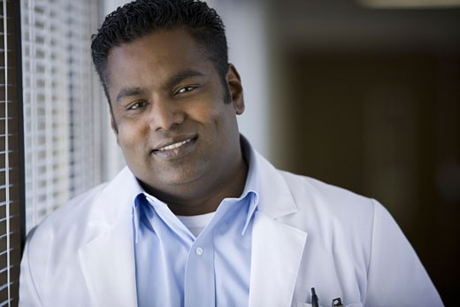 Portrait of a male doctor smiling : Stock Photo