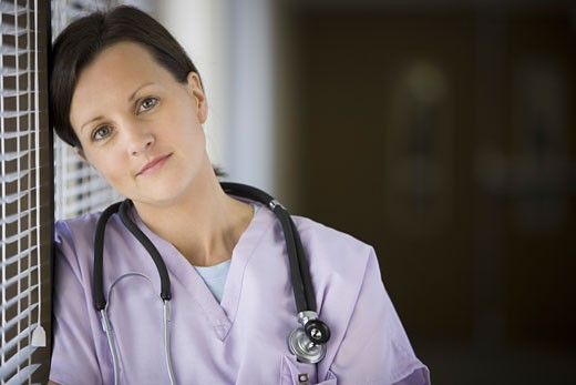 Stock Photo: 1660R-6173 Close-up of a female nurse with stethoscope around her neck