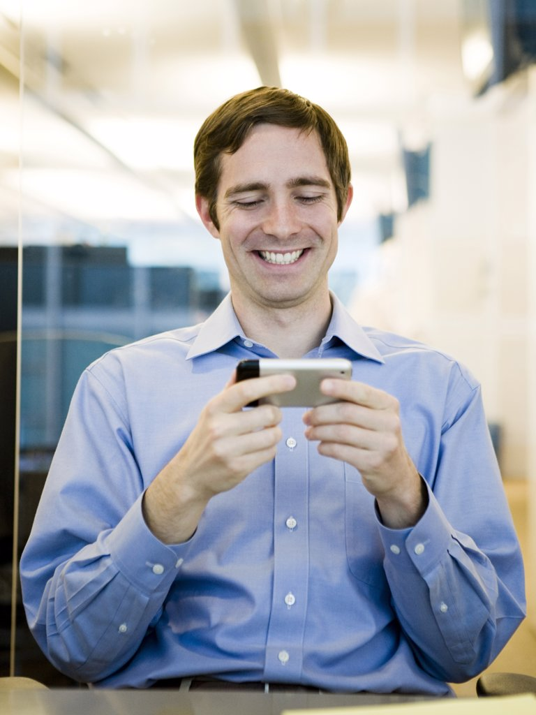 man in a blue shirt at work : Stock Photo
