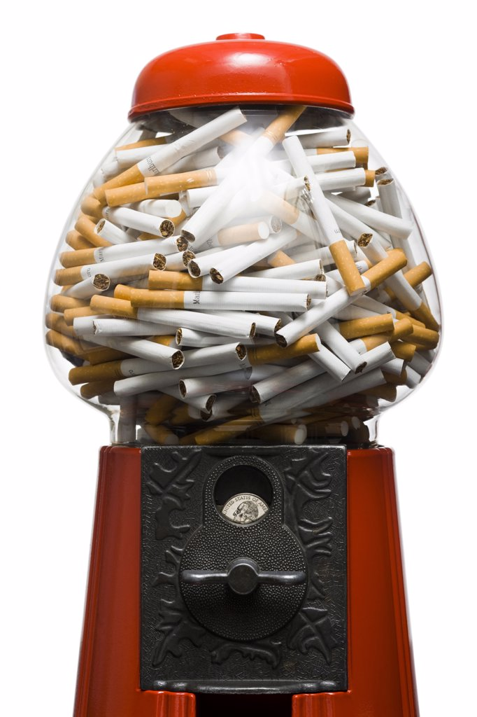 Stock Photo: 1660R-62006 gumball machine full of cigarettes