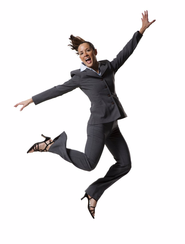 Businesswoman jumping with arms raised : Stock Photo