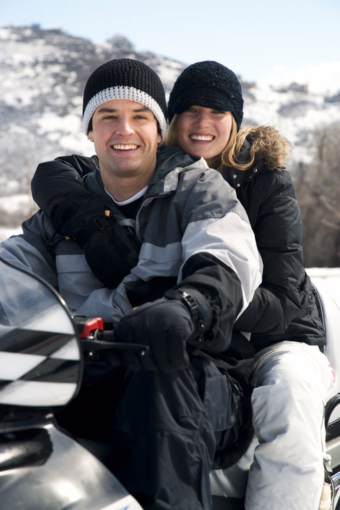Stock Photo: 1660R-62550 Couple on snow mobile