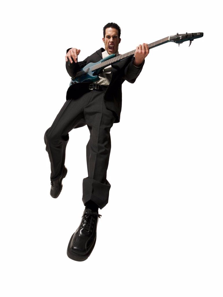 Stock Photo: 1660R-62640 Man jumping with electric guitar