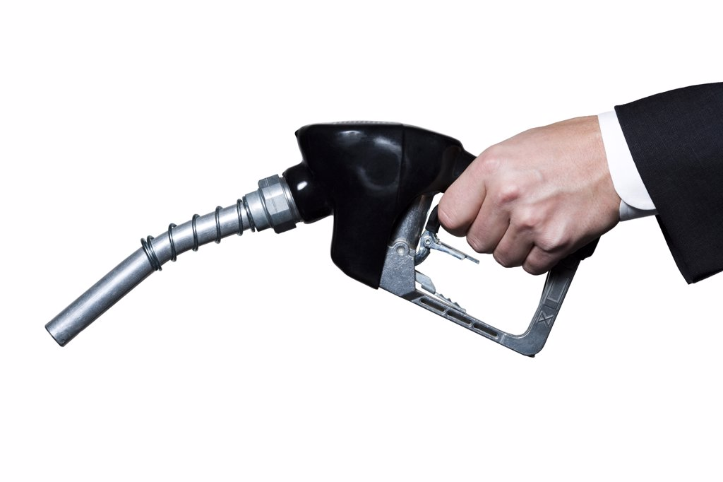 US banknotes emitting from gas pump nozzle : Stock Photo