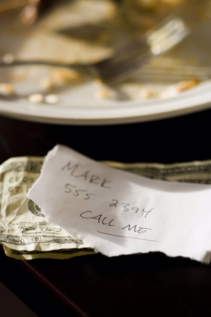 Soiled plate with fork and memo : Stock Photo