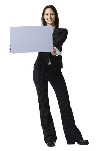 Stock Photo: 1660R-63065 Woman holding a blank sign