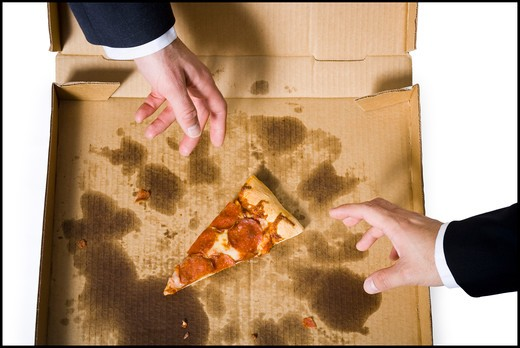 Stock Photo: 1660R-63092 Two hands reaching for last slice of pizza