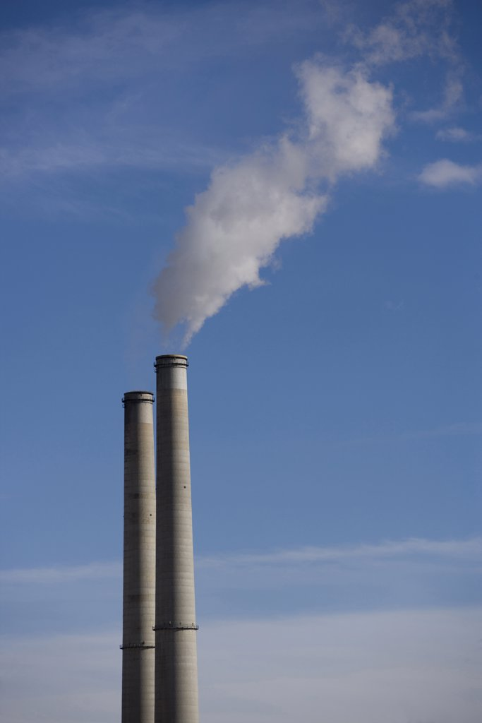 Smoke coming out of smoke stacks : Stock Photo