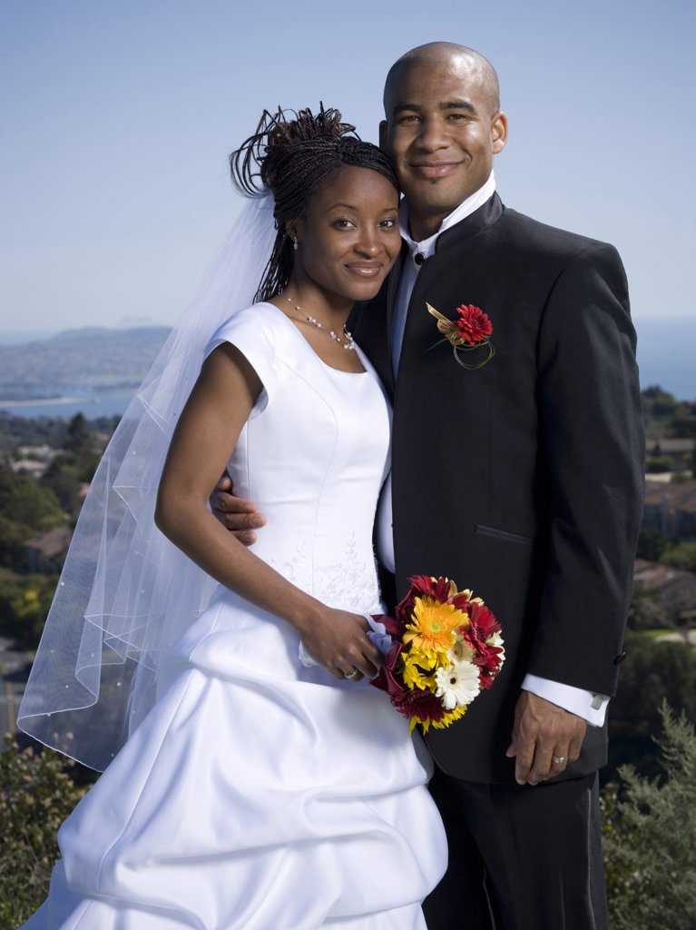 Stock Photo: 1660R-63563 Portrait of a newlywed couple smiling together