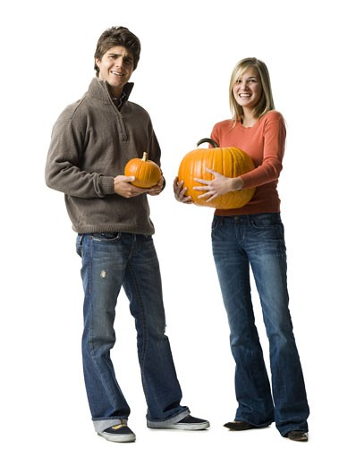 Stock Photo: 1660R-6437 Portrait of a young couple holding pumpkins