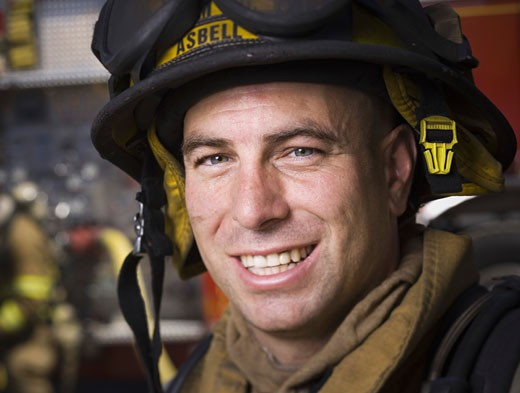 Close-up of a firefighter wearing a helmet : Stock Photo
