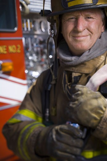 Portrait of a firefighter smiling : Stock Photo