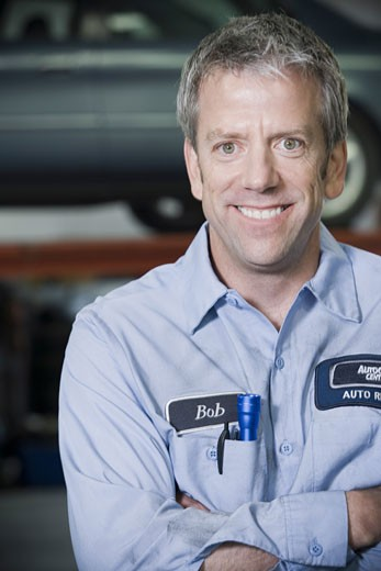 Stock Photo: 1660R-6695 Close-up of a mechanic with his arms crossed