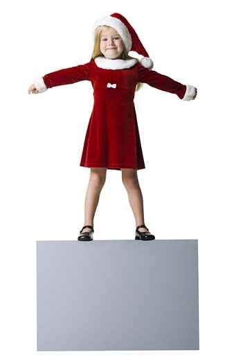 Stock Photo: 1660R-6790 Portrait of a girl standing with her arms outstretched on a blank sign