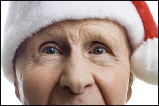 Stock Photo: 1660R-7023 Portrait of a senior man wearing a Santa hat