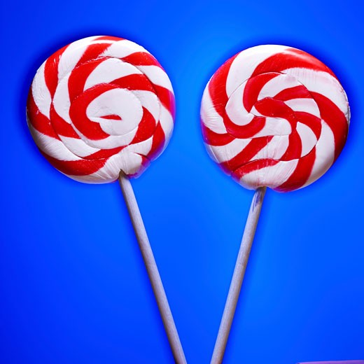 Close-up of two lollipops : Stock Photo