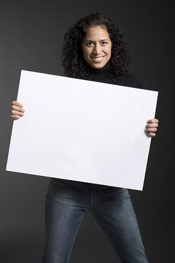 Stock Photo: 1660R-7596 Portrait of a woman holding a blank sign and smiling