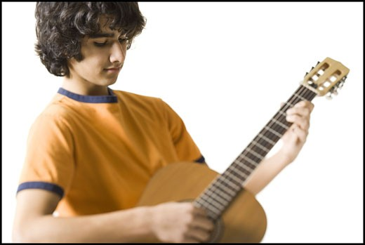 Stock Photo: 1660R-7761 Close-up of a teenage boy playing the guitar