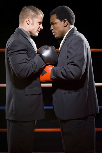 Profile of two businessmen staring at each other in a boxing ring : Stock Photo