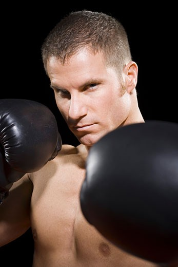 Portrait of a young man boxing : Stock Photo