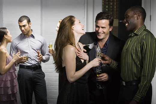 Stock Photo: 1660R-8038 Group of people talking at a party
