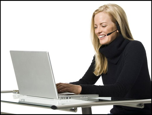 Stock Photo: 1660R-8048 Close-up of a businesswoman working on a laptop