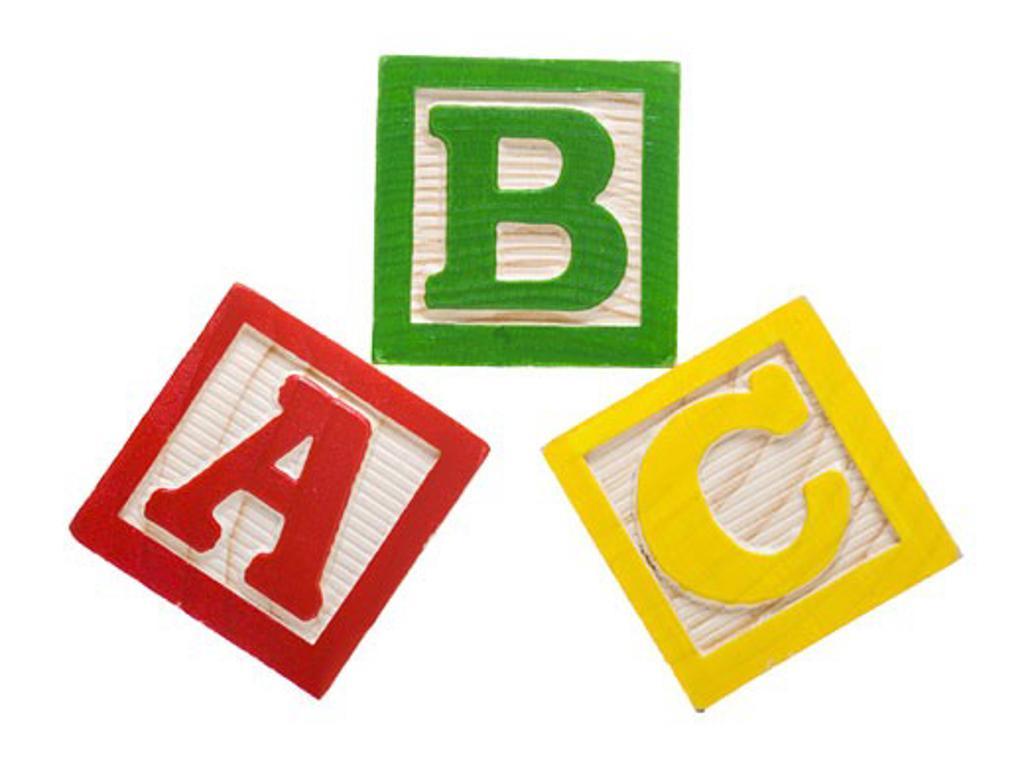 Close-up of three alphabet blocks : Stock Photo