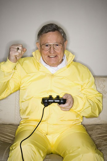 Stock Photo: 1660R-8120 Senior man playing a video game