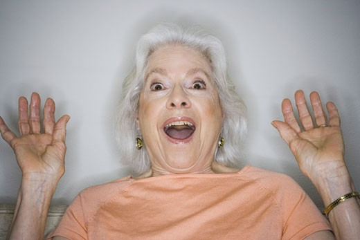 Stock Photo: 1660R-8143 Portrait of a senior woman looking surprised
