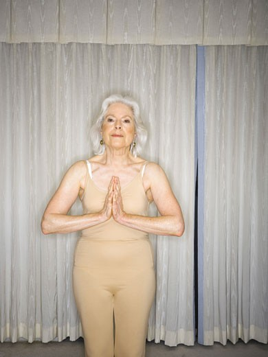 Portrait of a senior woman practicing yoga : Stock Photo