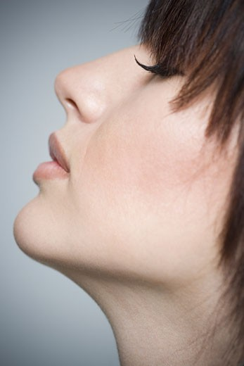 Stock Photo: 1660R-8220 Close-up of a young woman with her eyes closed