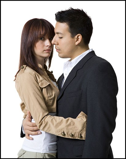 Stock Photo: 1660R-8223 Profile of a young couple embracing each other