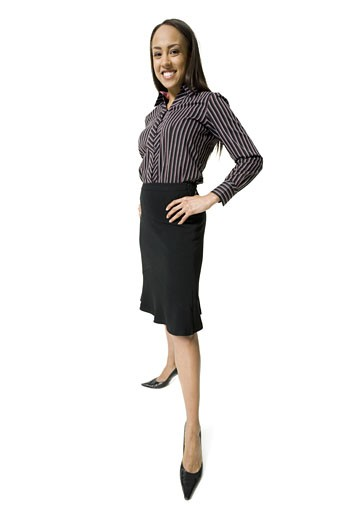 Portrait of a businesswoman standing with hands on hips : Stock Photo