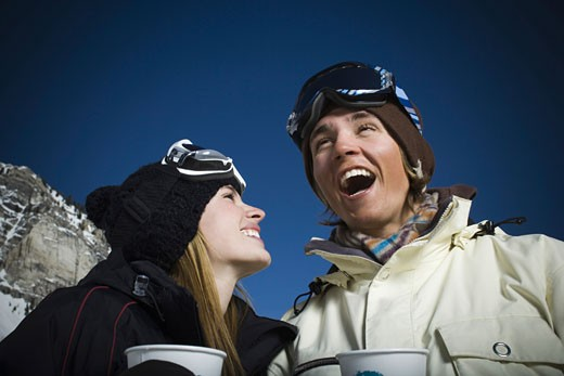 Low angle view of a young couple smiling : Stock Photo