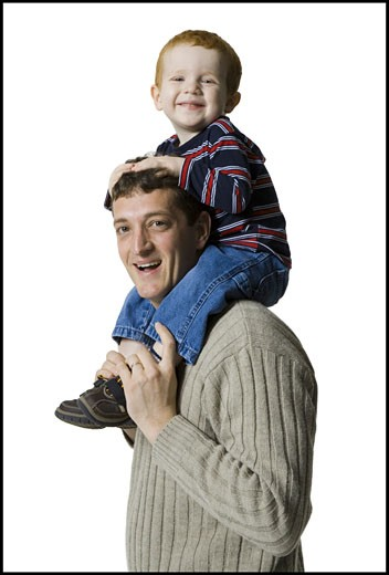 Stock Photo: 1660R-8571 Profile of a father carrying his son on his shoulders