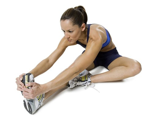 Close-up of a woman stretching her legs : Stock Photo