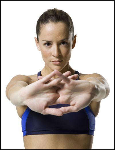 Stock Photo: 1660R-8631 Portrait of a woman stretching her arms