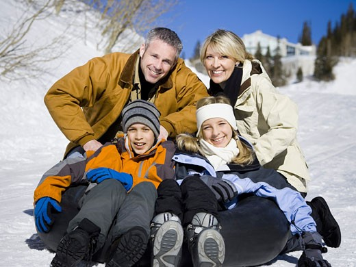Portrait of parents with their two children smiling : Stock Photo