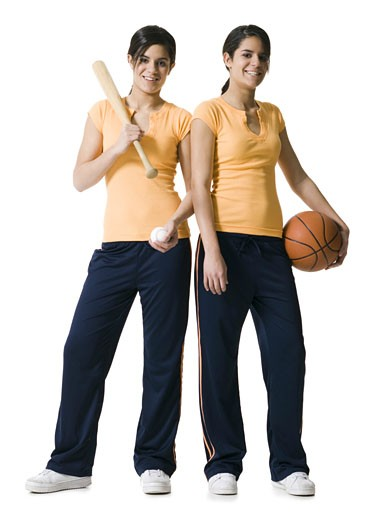 Stock Photo: 1660R-8813 Portrait of two teenage girls holding a baseball bat and a basketball