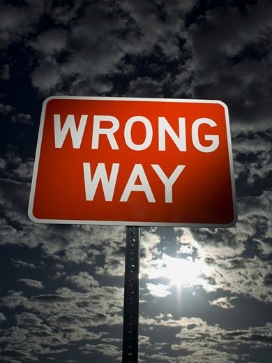 Stock Photo: 1660R-8845 Low angle view of a wrong way sign