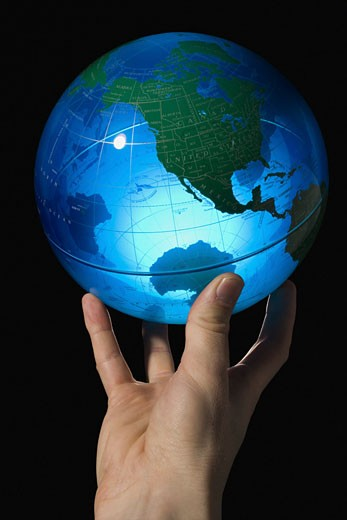 Stock Photo: 1660R-8925 Close-up of a man's hand holding a globe