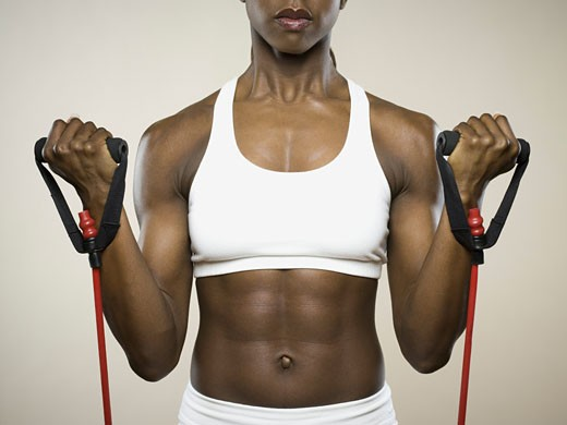 Stock Photo: 1660R-8933 Close-up of a young woman exercising with a jump rope