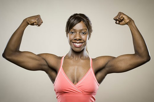 Stock Photo: 1660R-8937 Portrait of a young woman flexing her muscles