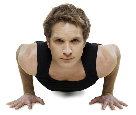 Portrait of a young man doing push-ups : Stock Photo