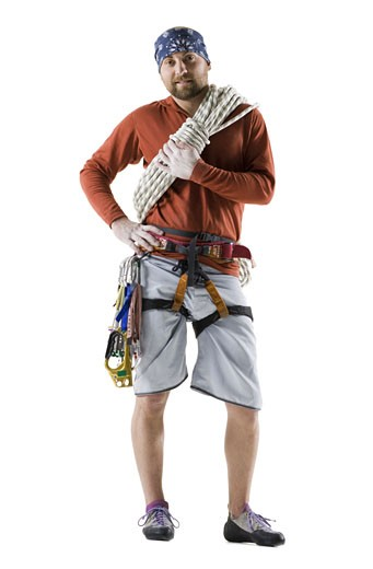 Portrait of a young man with rock-climbing gear : Stock Photo