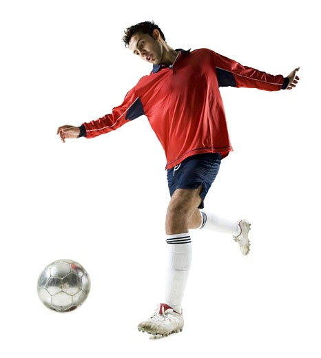 Low angle view of a young man playing with a soccer ball : Stock Photo
