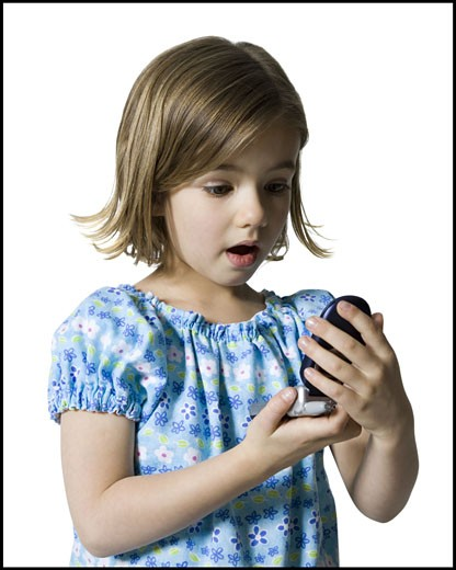 Stock Photo: 1660R-9218 Close-up of a girl holding a mobile phone