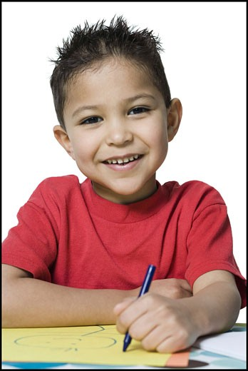 Stock Photo: 1660R-9254 Portrait of a boy drawing with crayons